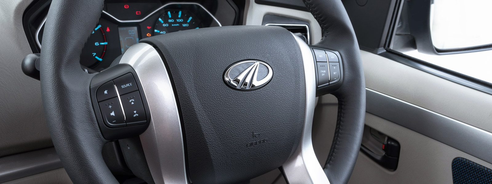 Steering-mounted controls for phone, audio, and cruise function