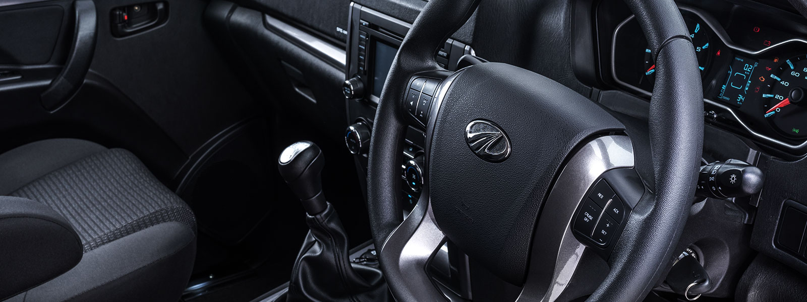 Steering mounted phone, audio, and cruise functions